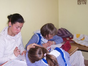 Ioana doing homework with the kids