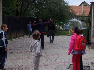 Some of the kids playing in the yard